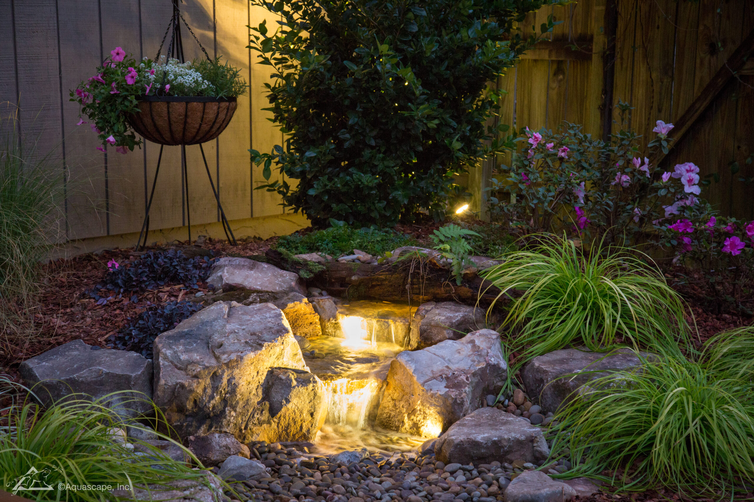 Backyard Waterfall with lights   Brookside Landscape Design